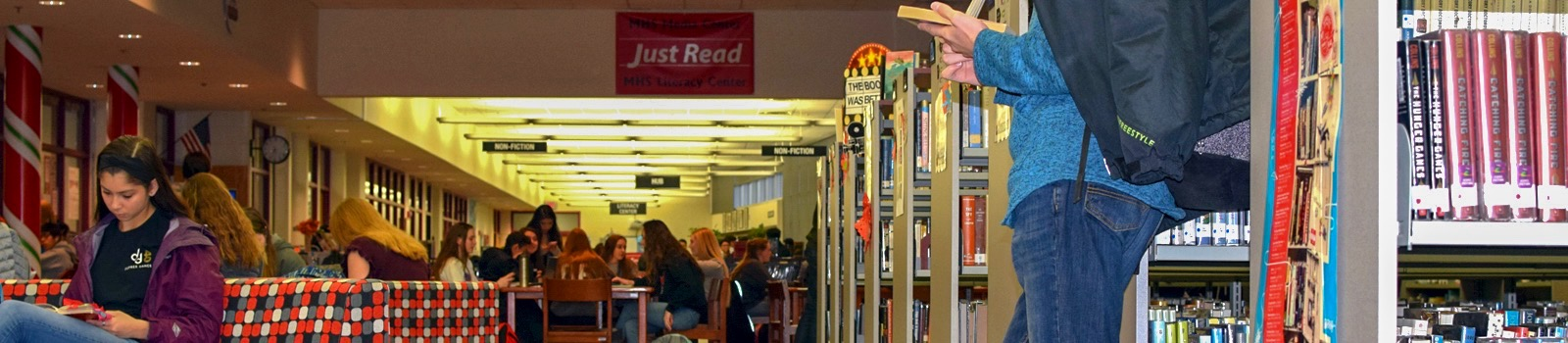 students reading in media center