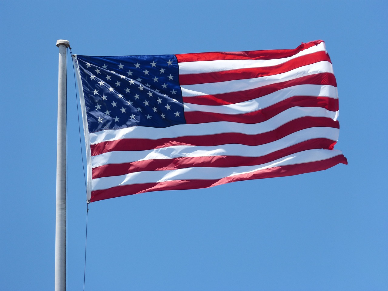Image of an American flag blowing in the breeze