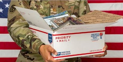 Photo of military accepting boxes of goods
