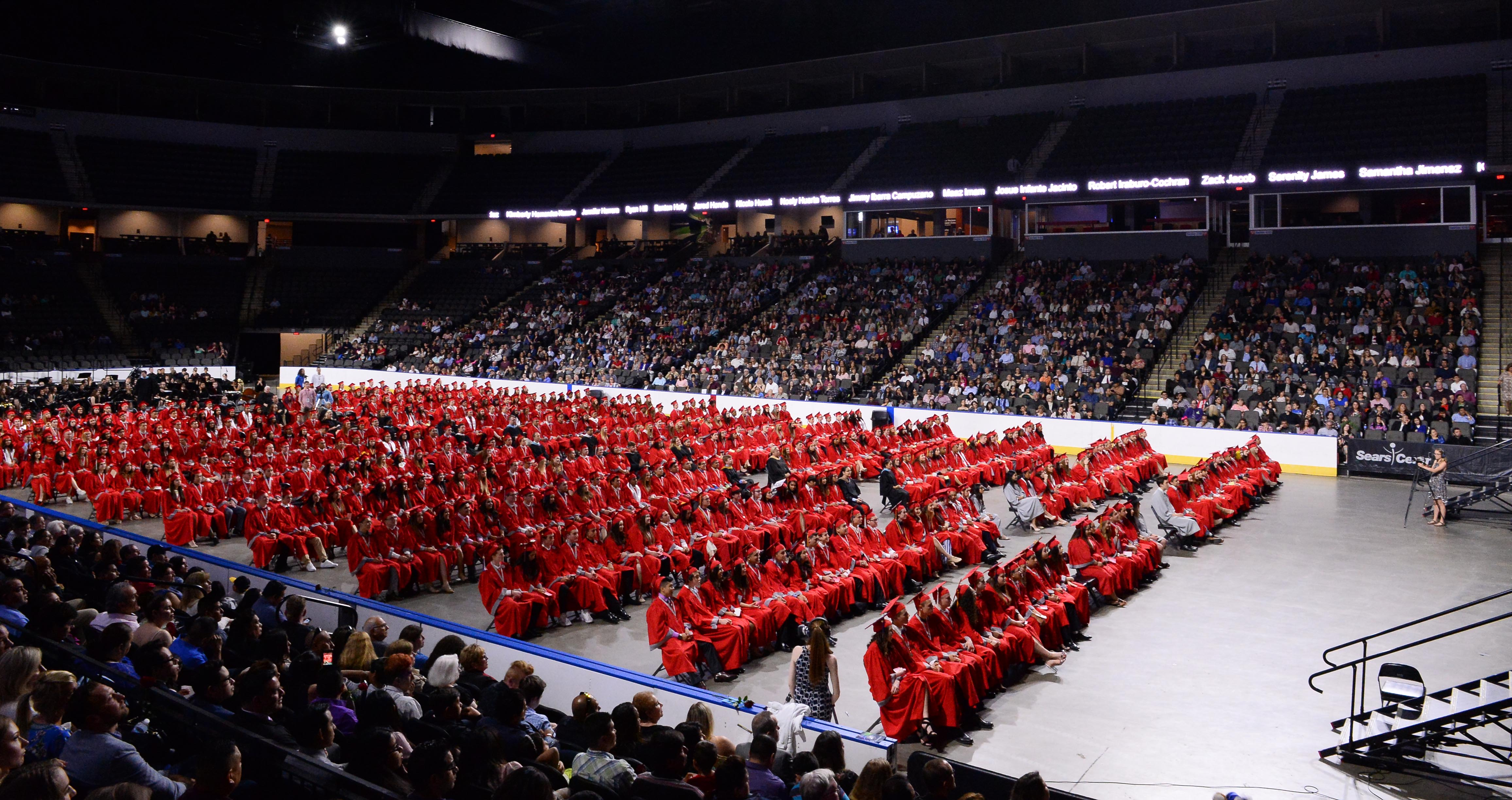 Class of 2018 in red caps and gowns at Graduation