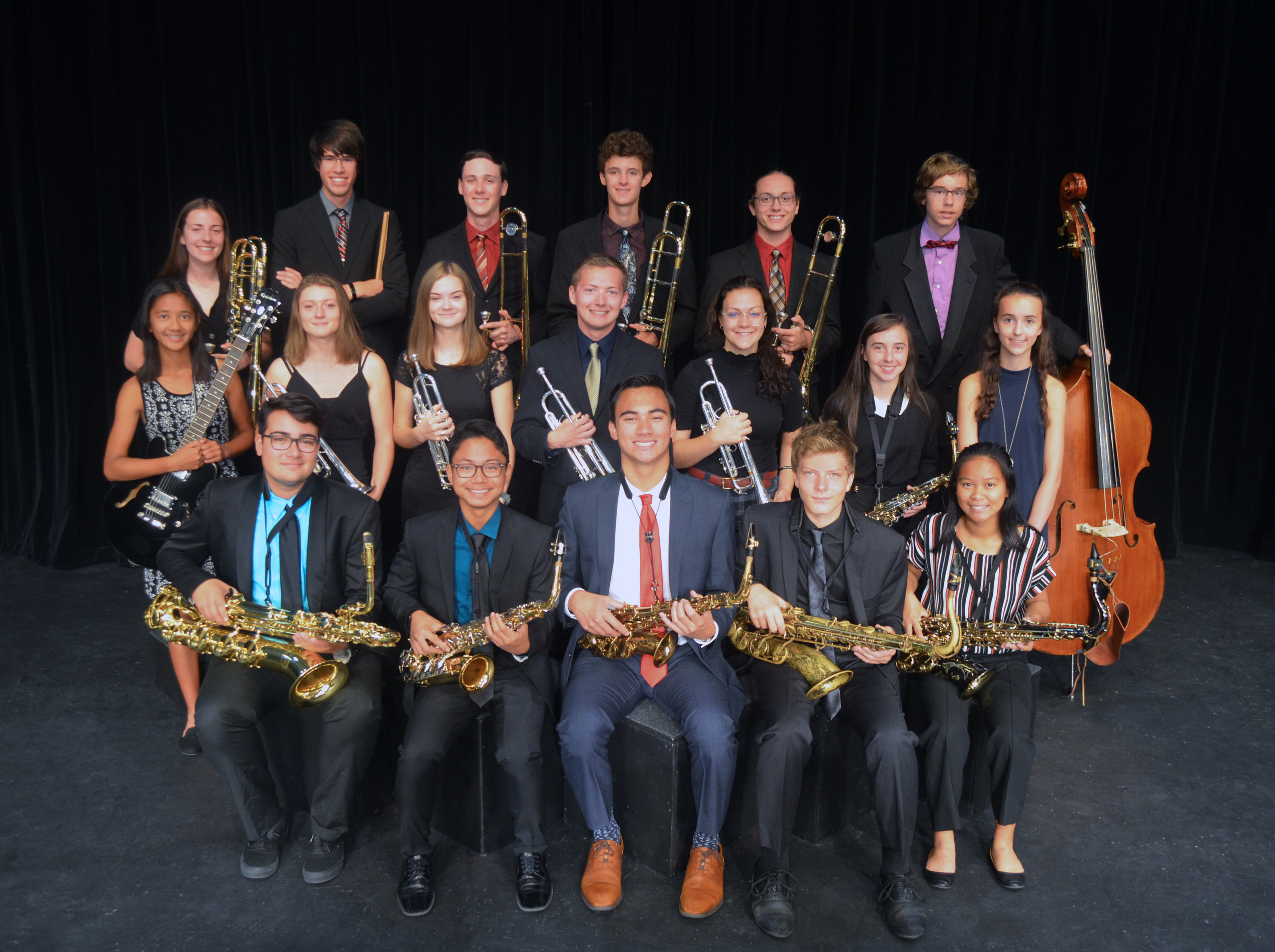 Group photo of jazz ensemble with their instruments