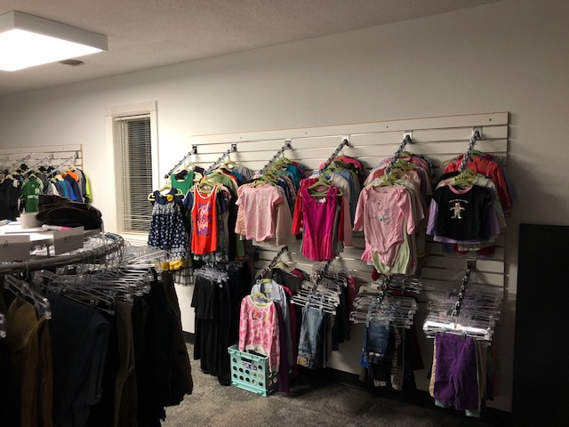 Rack of colorful clothing in the new location