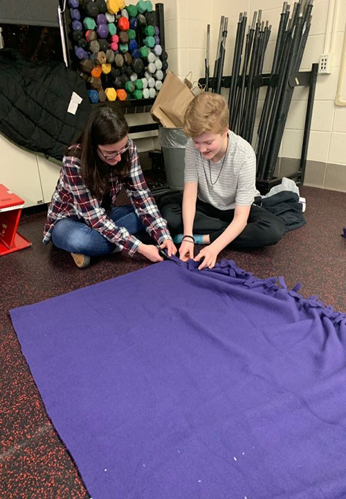 Brooke Testin and Ashley Carrier create felt blankets for cancer treatment patients