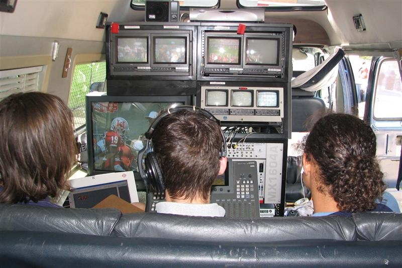 students inside tv van